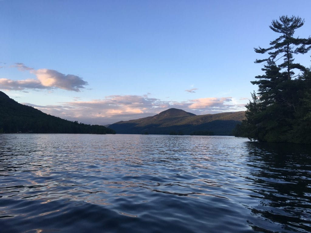 Mountains, calm waters and tree lined coast of Lake George, New York