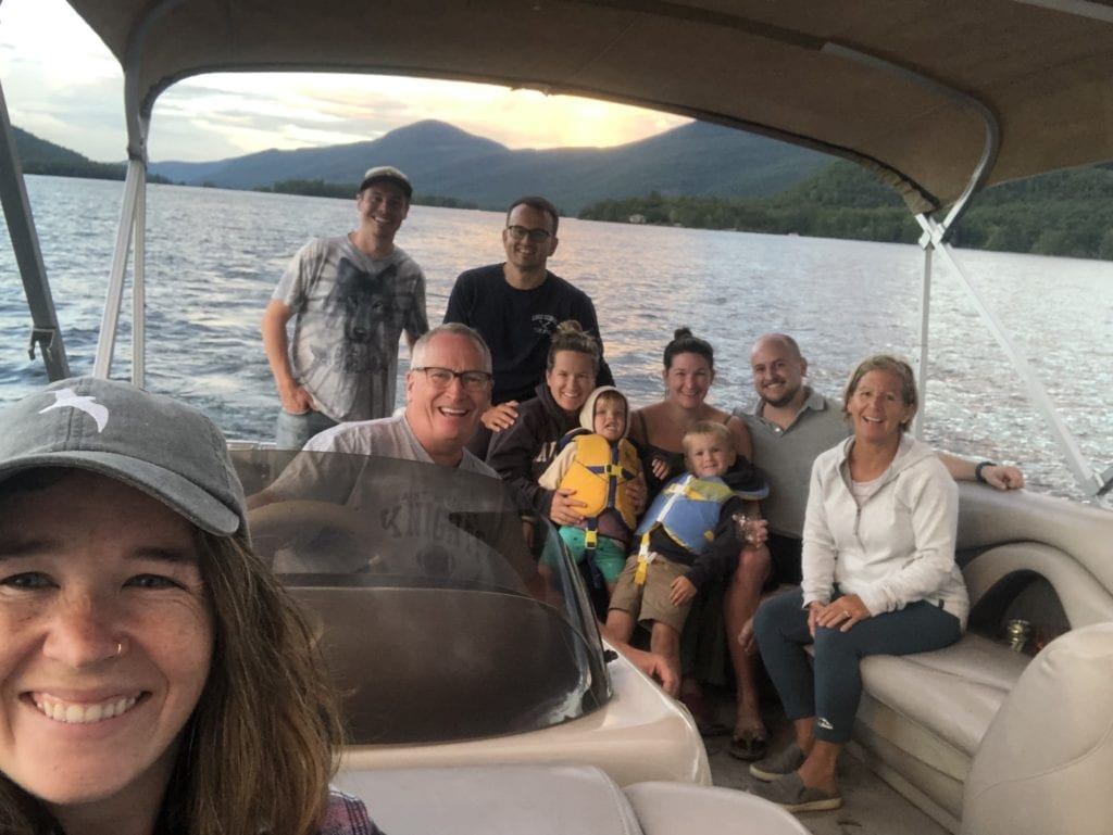 The Lucey Family in a boat on Lake George, New York after family camping trip tradition reimagined