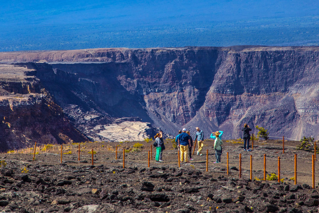 Visitors photograph the changes at Halema'uma'u Crater from the Keanakāko'i side