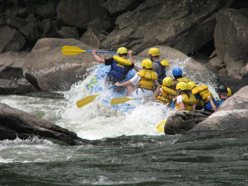 Rafters paddle through whitewater at the Fayette Station Rapids