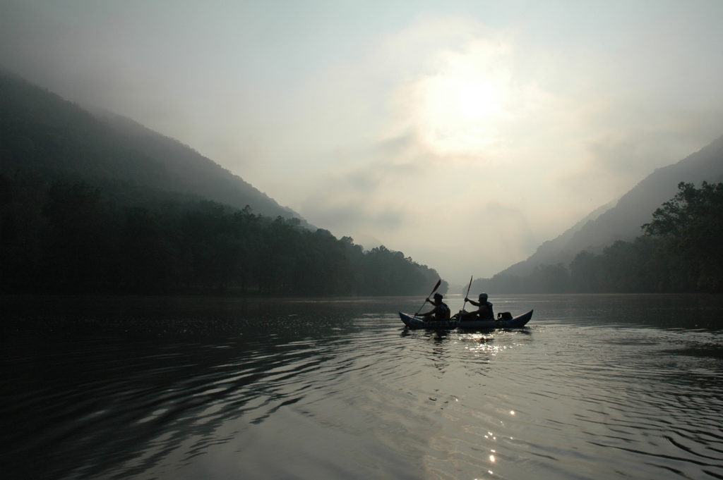 Two people in a boat on calm water