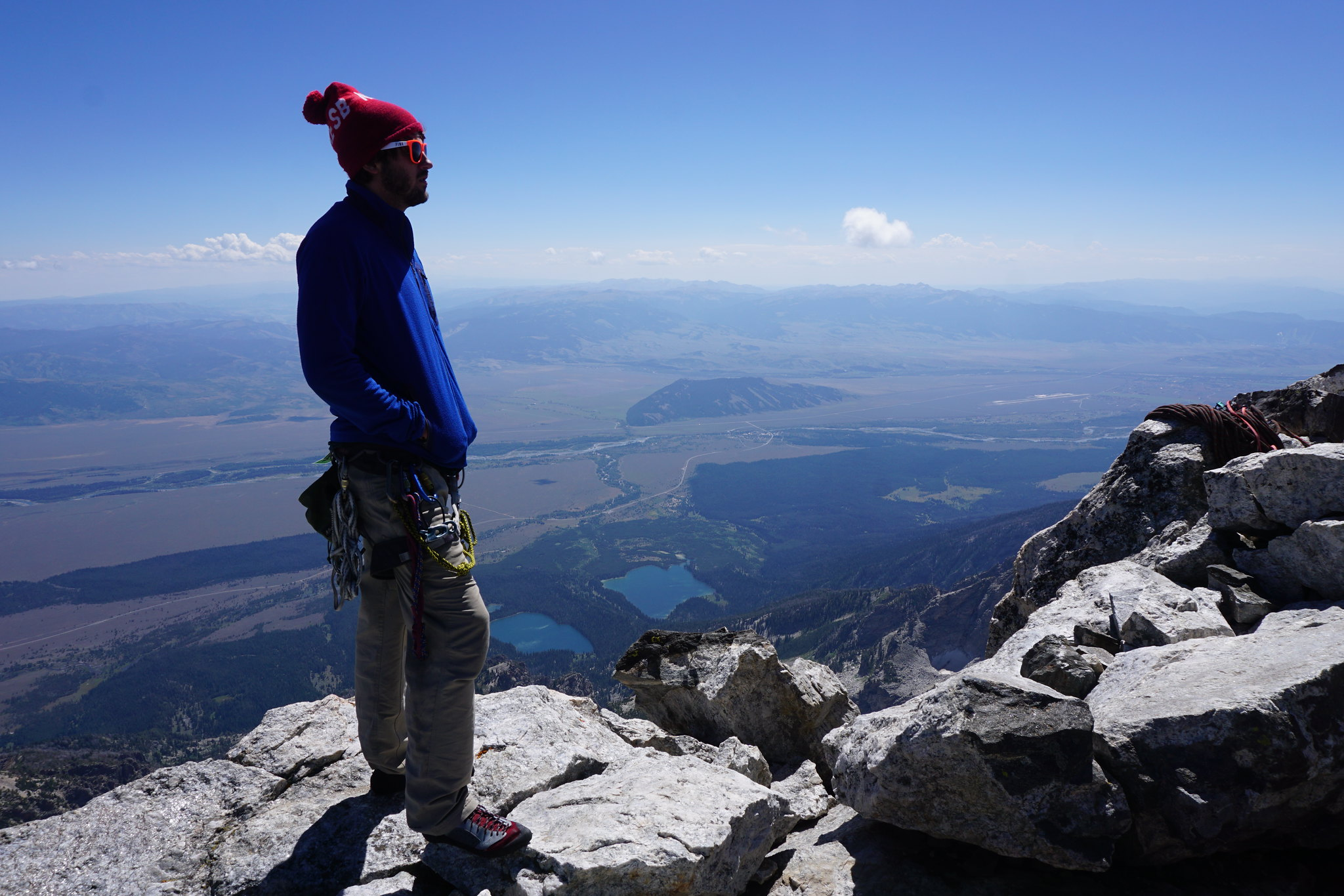 Male climber overlooking the valley below the Tetons